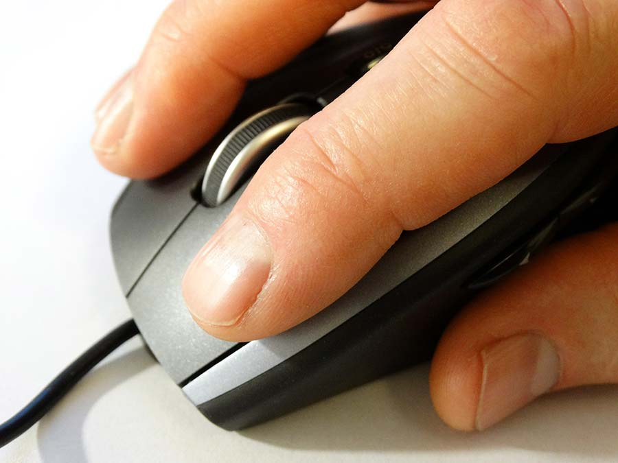 hand on mouse ready to click